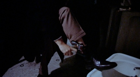 gene-hackman-in-the-french-connection-adjusts-his-ankle-holster