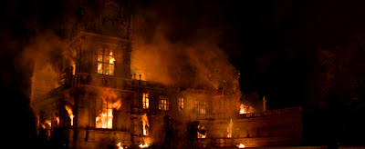 batman begins wayne manor burns